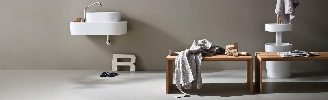 Betonlook coating badkamer van de interieur schilder